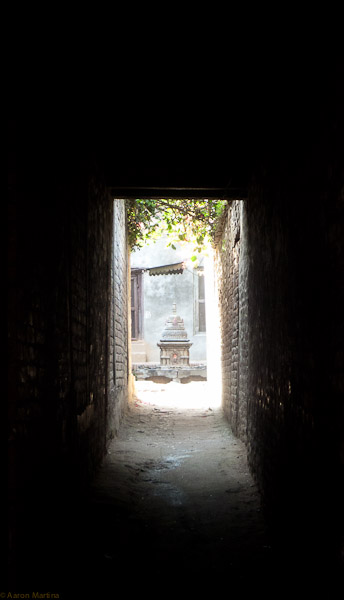 small stupa at the end of an alley