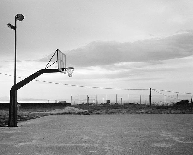 A hoop at dawn on #sifnos #greece #basketballhoop #basketball #blackandwhitephotography #mamiya7 #earlymorning #filmphotography