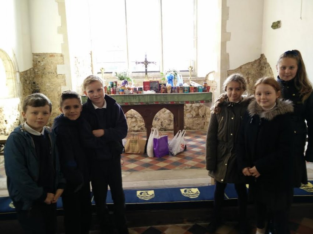 Year 6 Flitcham pupils oversee the Food Bank donations
