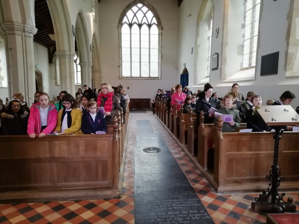 Flitcham pupils celebrating the Mothering service prior to clypping the church. 2019