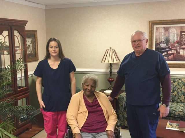 Mindy Thomas, Gloucester-Mathews Care Clinic Dental Coordinator; Florence Wallace, Resident at Riverside Convalescent Center in West Point; Dr. Jeff Raphael, Dentist at Gloucester-Mathews Care Clinic