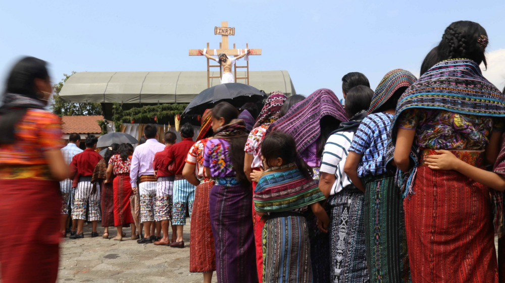 People wait in line at an Easter procession during Semana Santa in Santiago Atitlan, Guatemala.