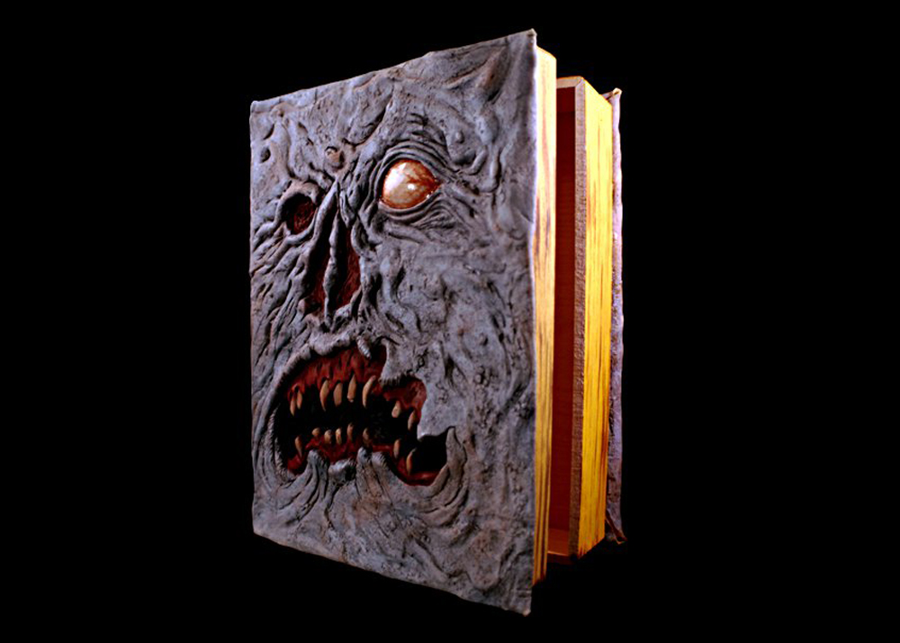 """EVIL DEAD"" Anniversary DVD in Necronomicon book package."
