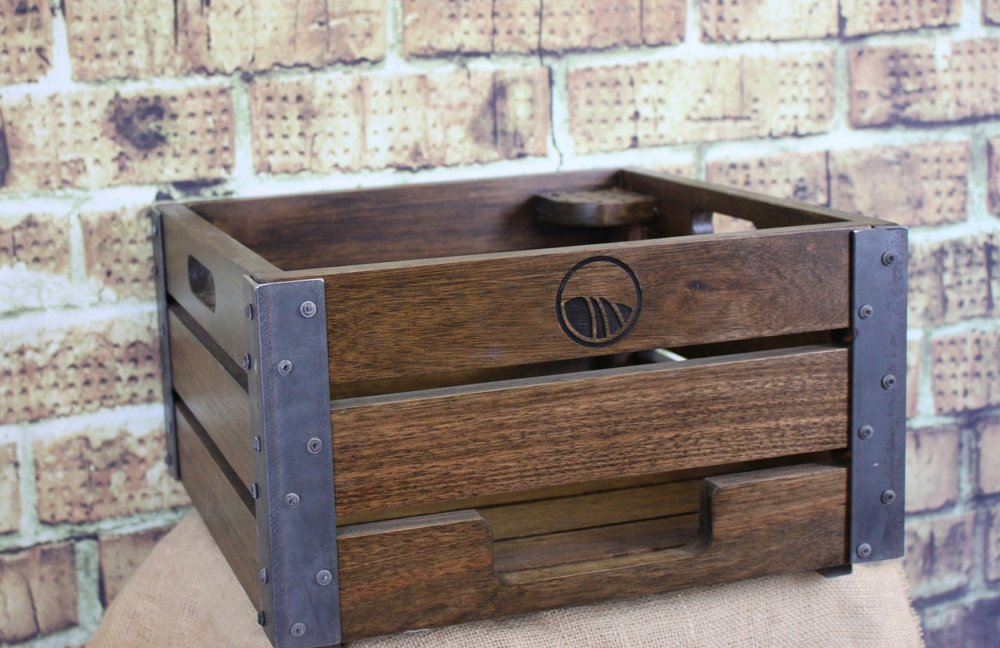 Our vintage industrial style crates are constructed with heavy duty steel reinforced corners from sustainable hardwoods.  Holds approximately 300 balls.  Includes engraved logo - $215