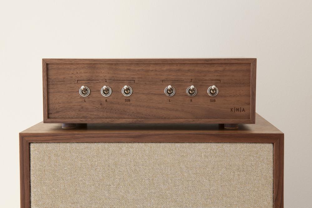 Custom K|M|A hardwood speaker selector box atop a K|M|A monitor.