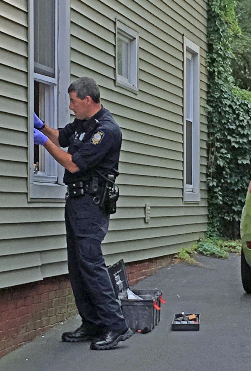 Portland Police officer V. Cote removing fingerprints from robbery scene at 94 Beckett Street Thursday afternoon. Photo: The Munjoy Hill Observer