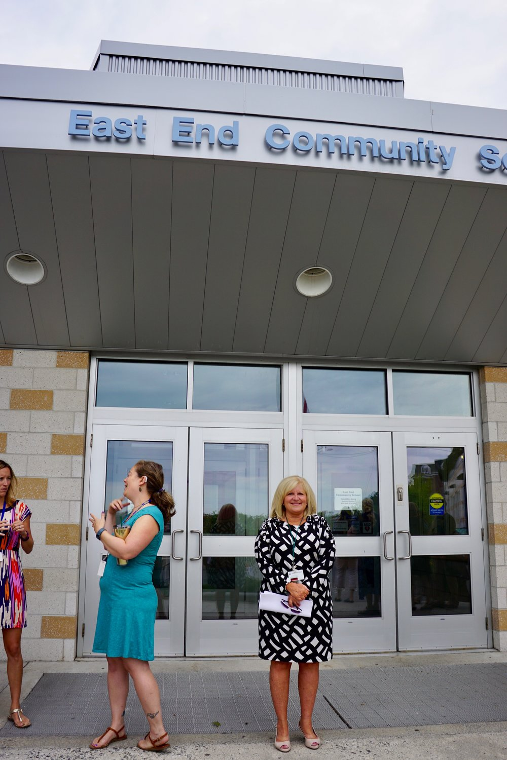 Principal Marcia Gendron greets students and parents at the entrance to the East End Community School Wednesday.