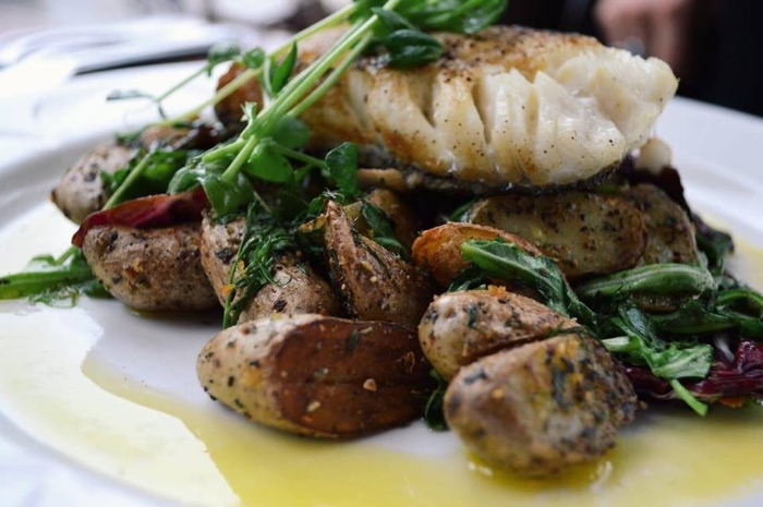 Roasted Fogo Island cod, warmed fingerling potatoes, radicchio, dill, lemon, arugula + cold pressed canola oil