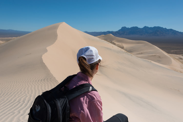 A visitor atop Kelso Dunes in the Mojave National Preserve.
