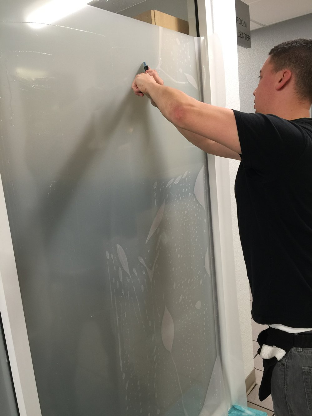 Aaron installing white frost privacy film