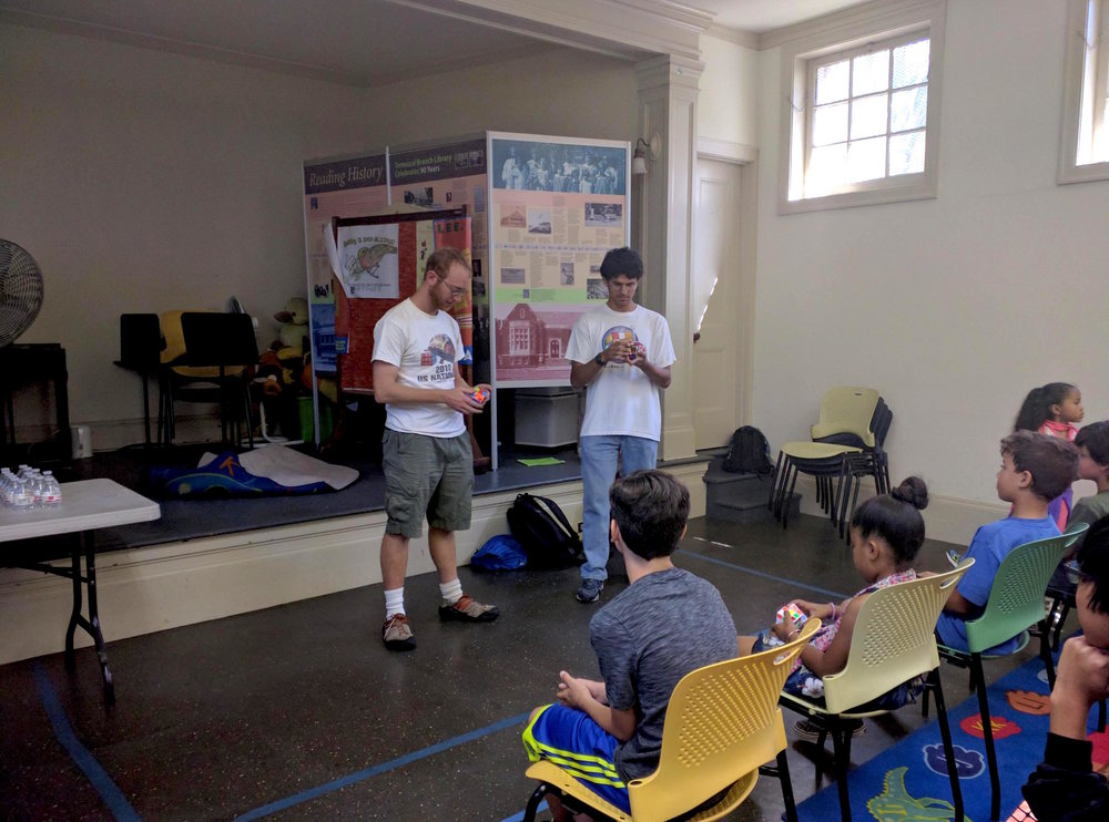 Instructor Ravi Fernando and USA Cubing Jeremy Fleishman demonstrate their magic speed solving skills. Go to our gallery to watch the video clip.