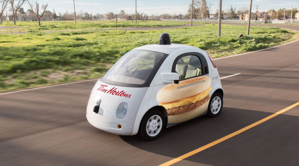 We create a fleet of self-driving cars to go all over the city, and try to get people to get inside. When people get inside, the cars will take them to Tim Hortons (and give them a free breakfast or they can order from inside the car)