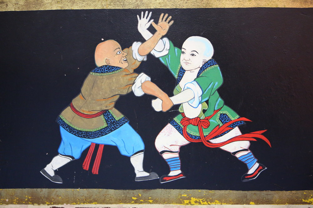 temple wall fighting monks3.JPG