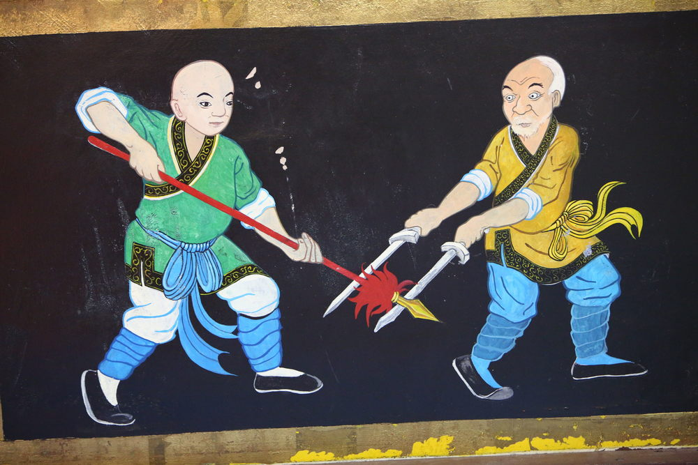 temple wall fighting monks8.JPG