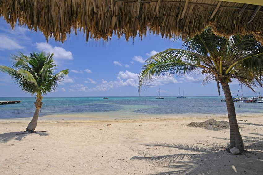 Slip on some flips flops and bask in the sunshine, snorkeling, and food adventures of San Pedro, Belize. Katy Patton, of HappyPlayces.com,shared her family's weekend vacation on the beach in San Pedro.  Copyright:123rf.com profile: vlkvojtech, Belize San Pedro beach