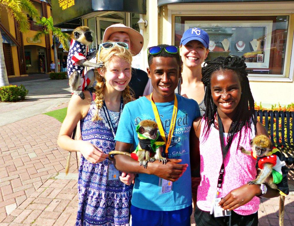 St. Kitts kids holding monkeys Royal Caribbean cruise