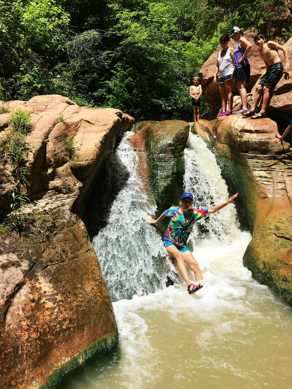 Hiking the Kanarra Creek Trail to Kanarraville Falls through a slot canyon in southern Utah is a hidden gem sitting in the backyard of Zion National Park.  Also near Bryce, your family needs to add this to your list when taking a vacation through gorgeous Utah!