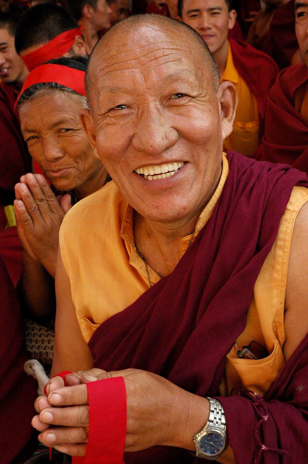Very_happy_Tibetan_Buddhist_Monk.jpg