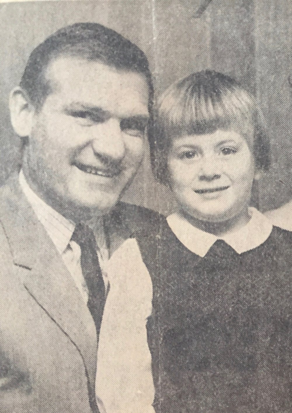 Dad and I in the newspaper, circa 1968, the apparent era of bowl shaped haircuts.