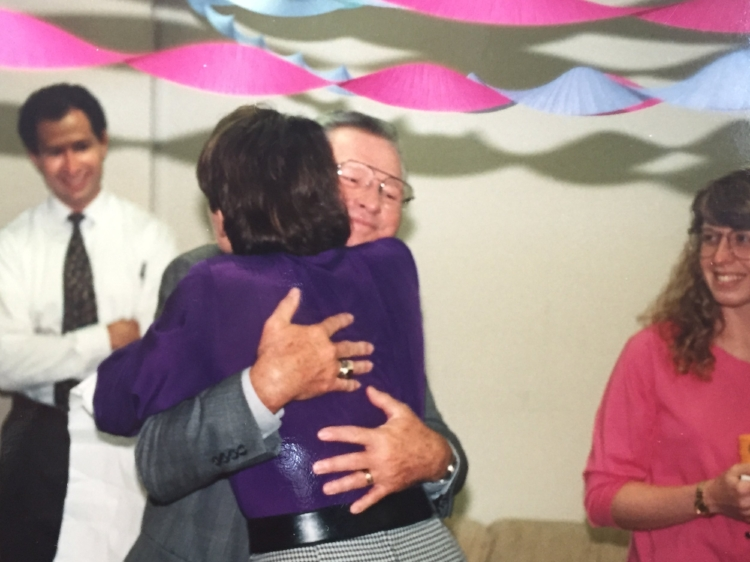 A hug from Lee Kinard, one of the world's best believers, with Doug Allred and Laura McGowan Murray looking on.