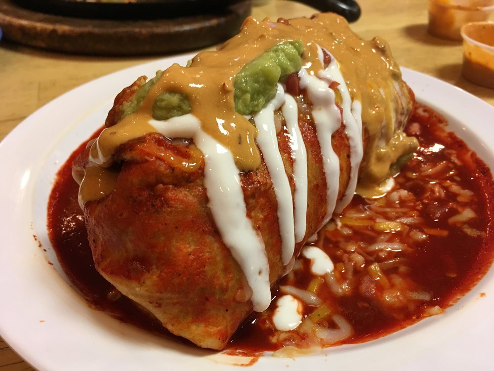 Pastor burrito smothered rojo from El Chubasco