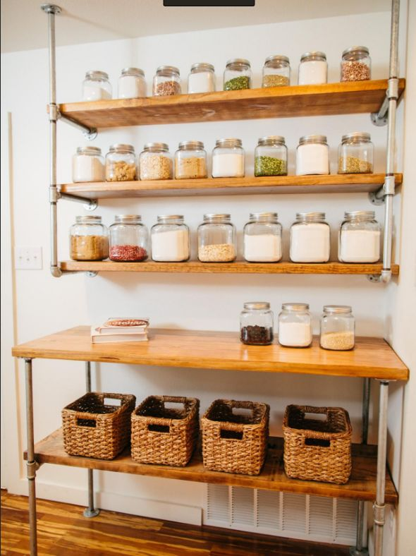 Open shelves fulled with containers and baskets via  pinterest