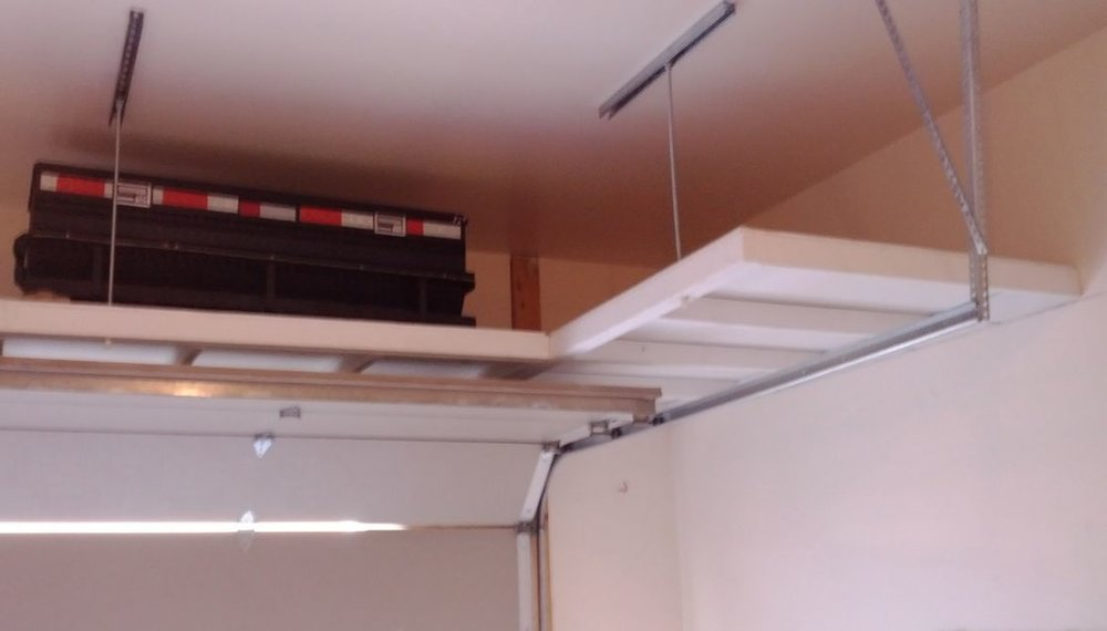 Budget Overhead Storage in wood painted white with an open underside