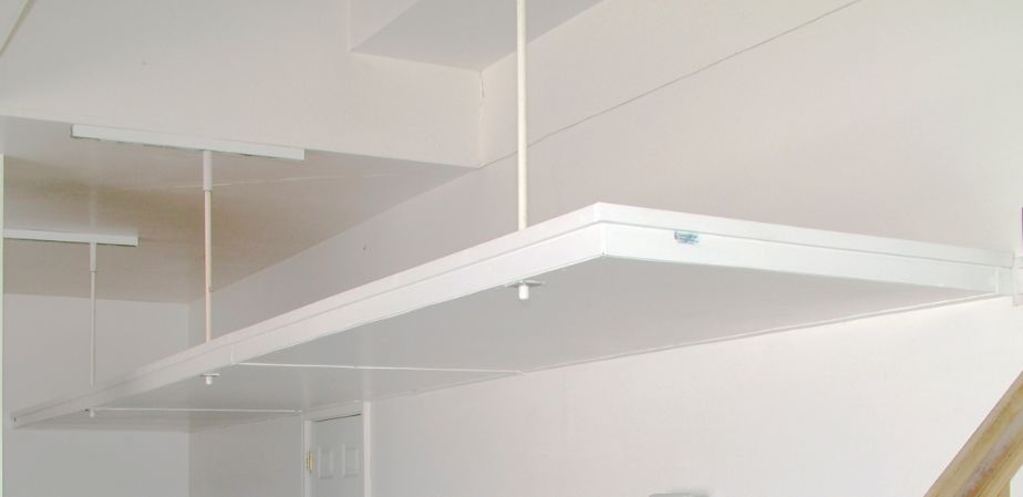 Budget Overhead Storage in wood painted white with a finished underside                                 -This option is also available unpainted.