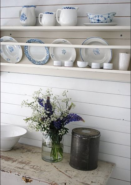 Antique shelves and dinnerware,white plates and jugs filled with greenery via  pinterest