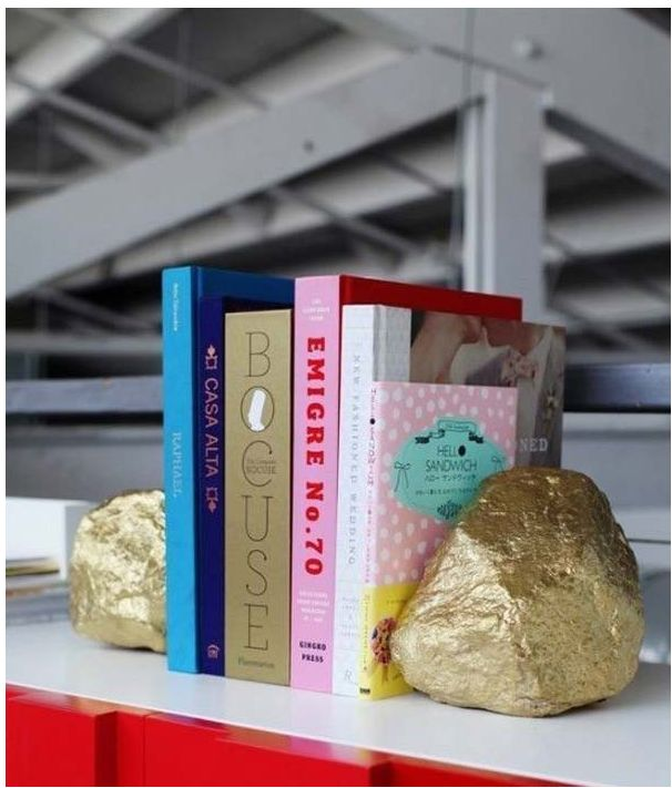 From  Design Love Fest .  These are a hack of bookends we've seen in high-end decorating stores!  Fun!!