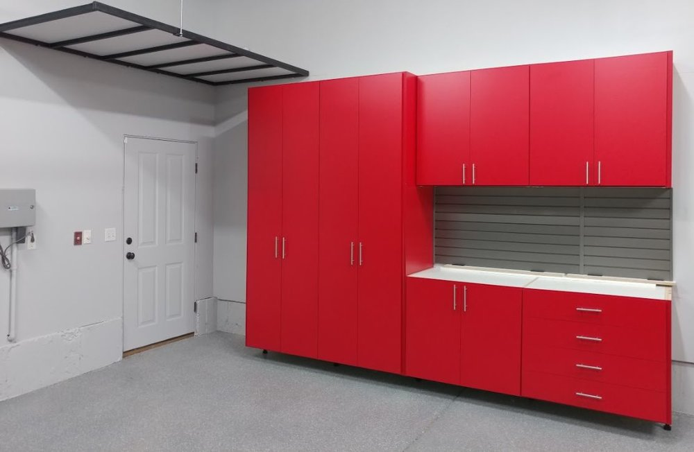 Go  HERE  for our unique continuous overhead storage that doesn't shake or move or rattle and roll (Ha!)! It looks clean and sleek without a lot of supports that get in your way as you are putting things in and out. Yet, the weight capacity of our units is greater!! You gotta love that!! In another post we'll show you how this unit looks with the workbench top. It's in. We're going back to do more work for this great client and will take a photo then.