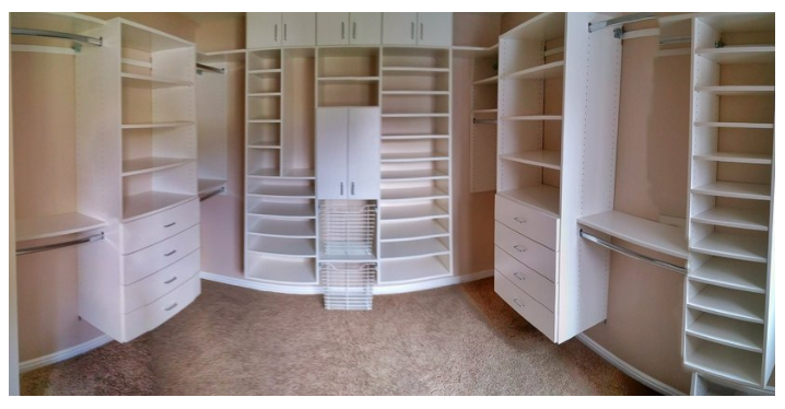 An efficient master closet design. You can take cabinets all the way to the ceiling and leave open space for tubs or baskets that provide easy access.