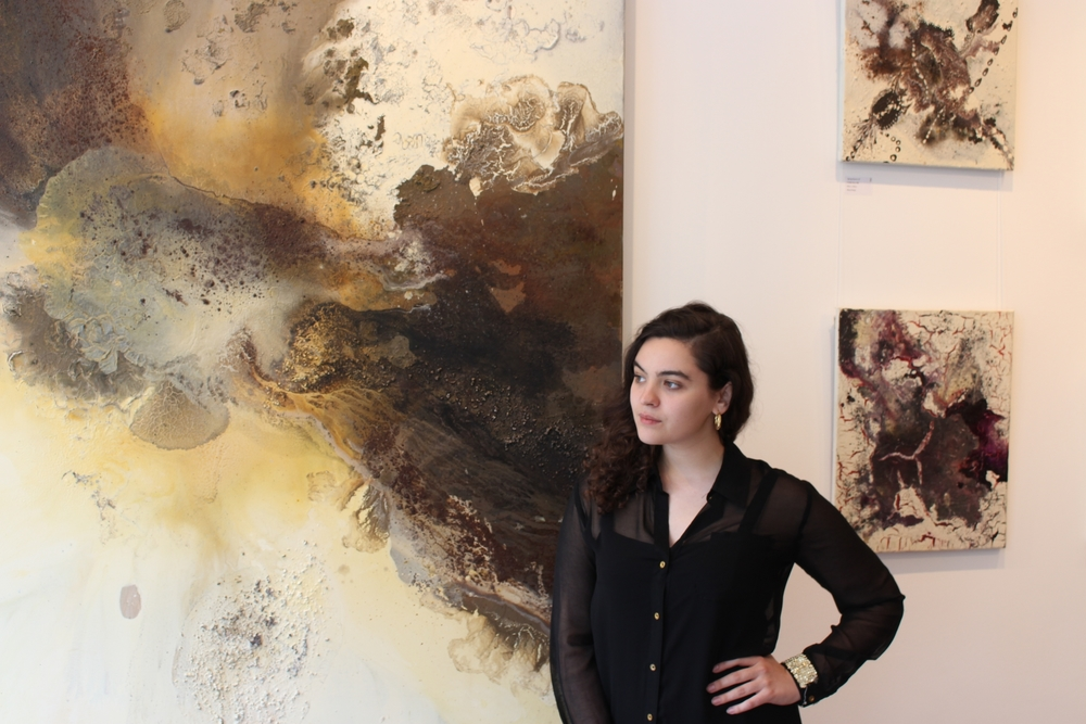 Morgane at the gallery with 'Crevice' by Maddie Rose Hills