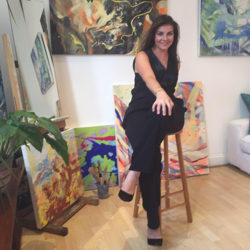 Minna George surrounded by her paintings