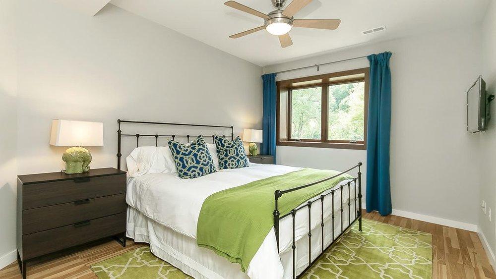 King bedroom on first floor Migraine retreat.jpg