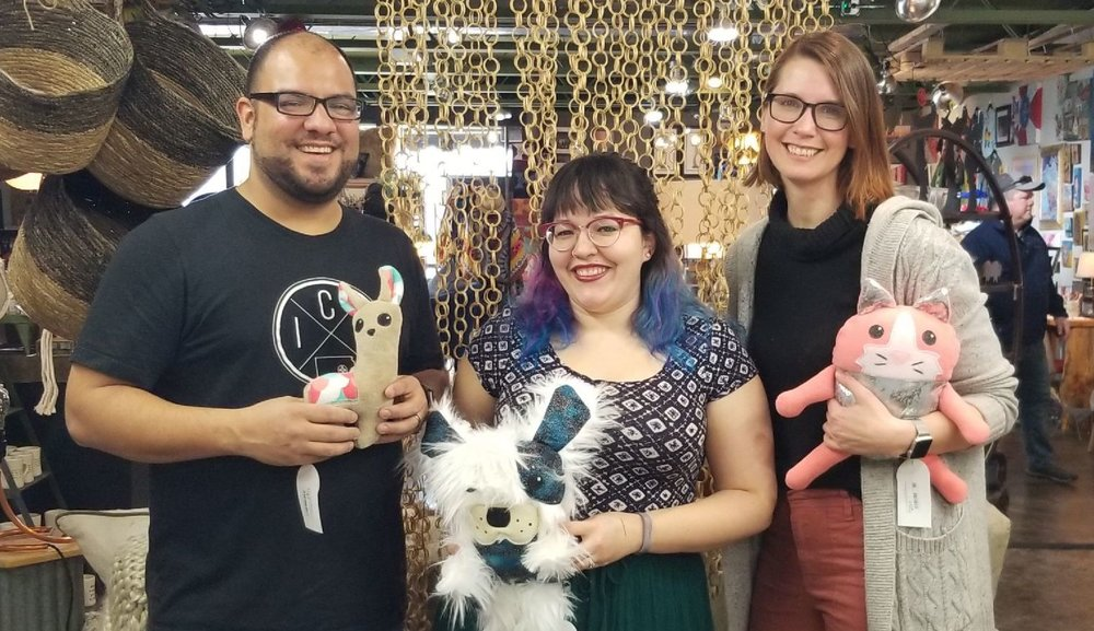 Jason, Heather Byers, and Renee with some of the Feather B creations