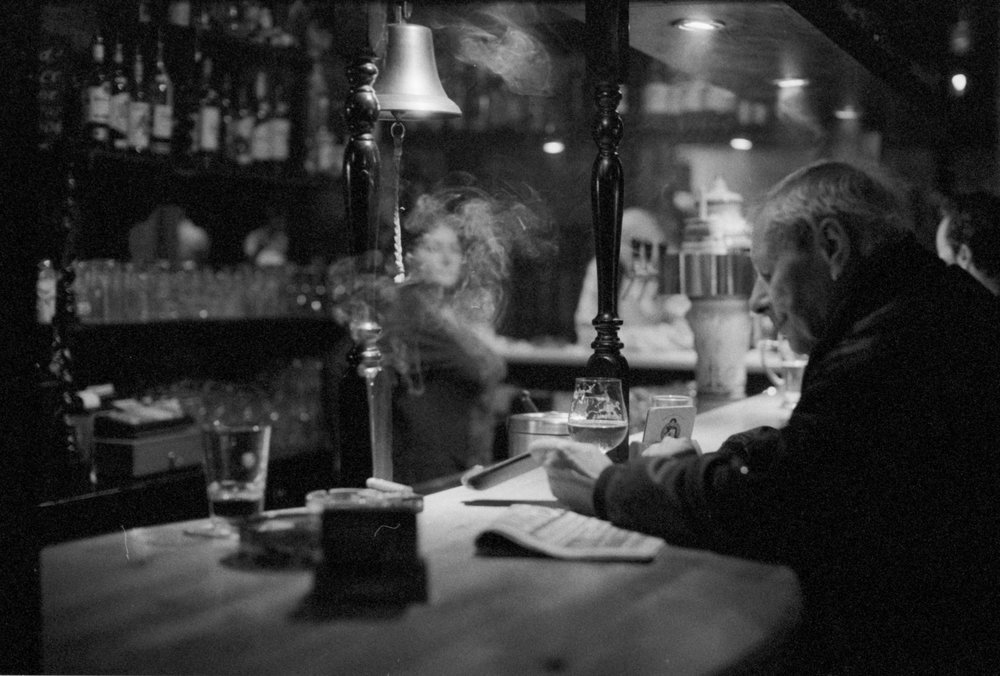 A Wednesday afternoon on a local bar in Neukölln, Berlin. These people meet up almost every day to have beers and talk about small and big issues in the world. Analogue pictures. 2016.