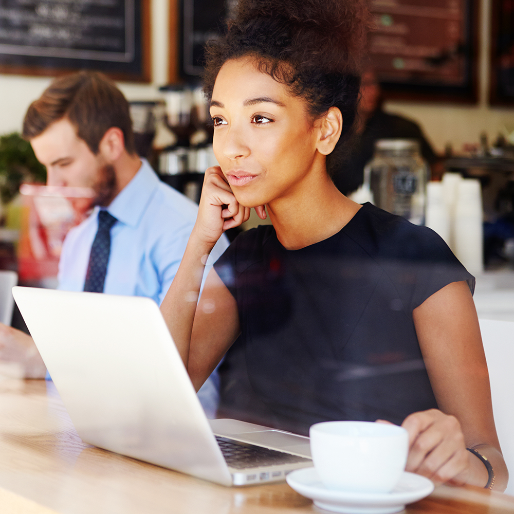 Copy of Businesswoman Using Laptop In Coffee Shop