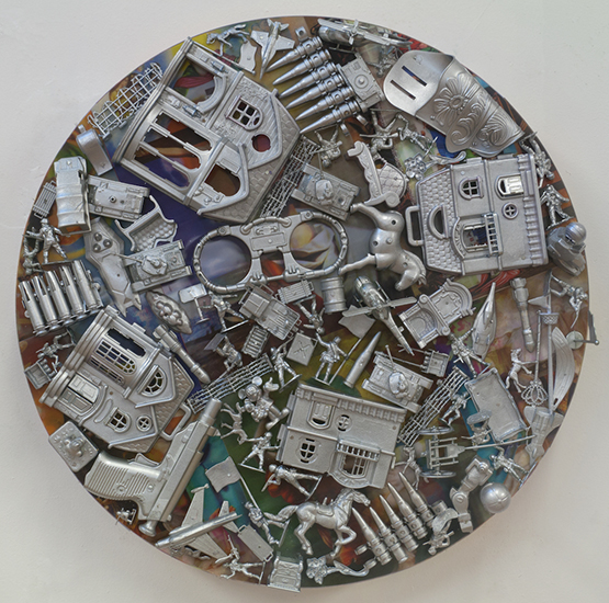"Margaret Roleke,   War Life,   2015, Lenticular Collage with Painted Plastic Toys on Wood Structure, 24"" in diameter by 8"" deep"