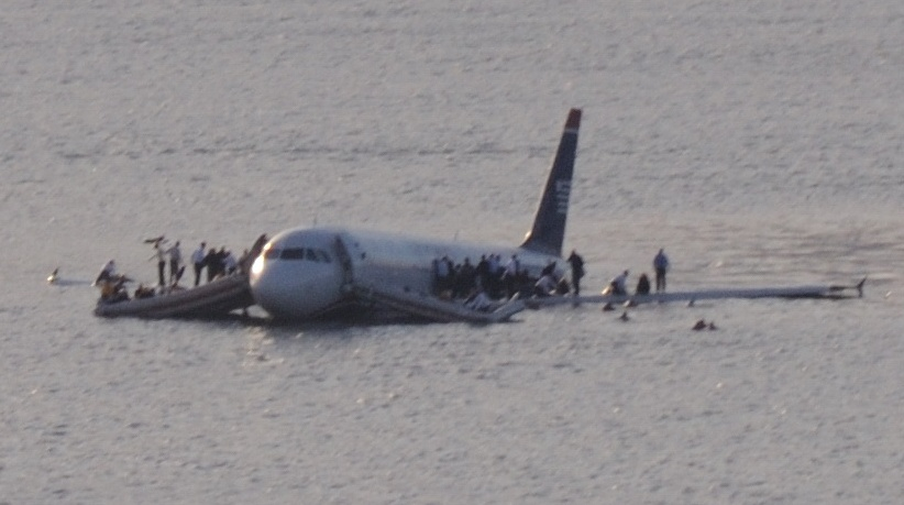 Passengers evacuate Flight 1549 after an emergency landing on the Hudson River.