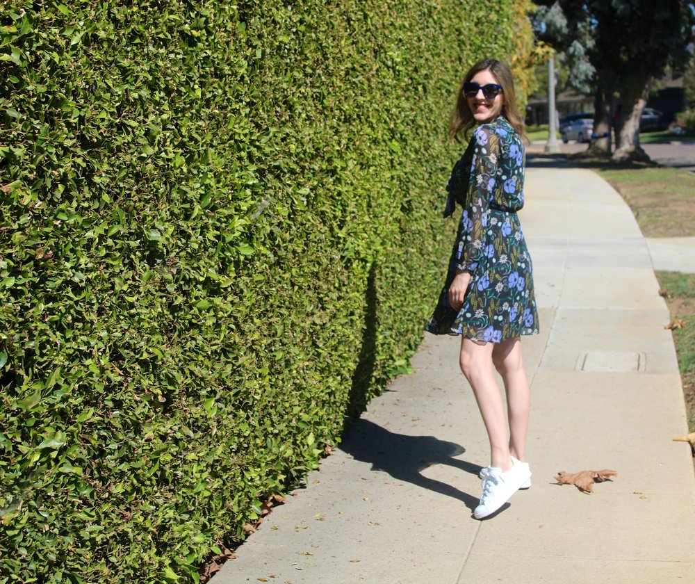 Dress:  Banana Republic   // Shoes:  Adidas    // Sunnies:  Chanel    This is a look I am loving right now with the weather being as stifling hot as it is! I love the contrast of a fancy dress mixed with the casualness of a sneaker. I never thought I would follow the Adidas Stan Smith originals trend, but I am glad that I did! These sneakers are super comfy but also look great with everything. I love the striking white of them and they look so cute when dressed up girly! Now onto this dress... I love that it is a dark floral which works perfectly for fall. When the weather cools down, I will be adding dark tights and an ankle boot to really bring this dress into true fall form. I also love that this dress has the added detail of a neck tie, which makes it even dressier so it can stand on its own if need be. Now if only the weather can match the colors on my dress!!!  As always, thanks for stopping by and keep following for more new looks!!! Ciao!!  xx Nicole