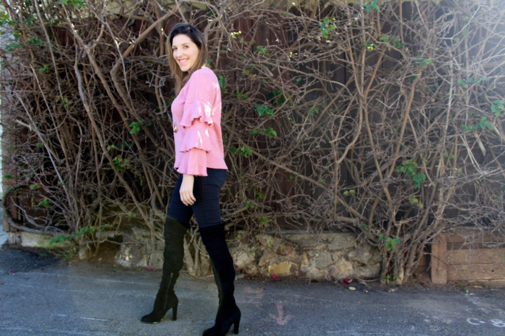 "Sweater:  MakemeChic  // Jeans: Flyi ng Monkey   // Necklace: Forever21 ,  similar here  // Boots: Jacobies,  similar here  // Sunglasses:  Le Specs ( ON SALE!!!)     Hi everyone and happy happy Friday! Here is a fun look to take you into the weekend. Now that it is getting colder, I am ecstatic that I can finally wear my boots and sweaters. These over the knee boots are super cute and fit perfectly on my little chicken legs. That's a big score in my book! If you have skinny legs like me, then you definitely need to go with an over the knee boot that has ties in the back, because loose ones will not be your friend even as much as you want them to be. I can't wait to pair these boots with a cute shift dress or sweater dress for the holidays! Stay tuned!    Sweaters are probably my favorite article of clothing besides shoes! I could wear a sweater everyday of my life if permitted. I usually tend to go for classic sweaters with a twist. Case in point is this sweater above. My friends tell me I dress ""grandma chic"" because of how many sweaters I own and wear! I love that at the base of this look it is just your average sweater, but the ruffled sleeves make it oh so much more. They make the sweater feel really unique and fancy, yet casual at the same time. This sweater can easily be paired with jeans like pictured here, or you can tuck it into a skirt or even throw it over a silky maxi dress, which is a huge look right now. I am a big fan of keeping my closet stocked with sweaters because they are such an effortless and classic piece that can be dressed up or down. And at the end of the day, I am a big fan of feeling comfortable while looking stylish, and sweaters always do just that for me!   Thanks for reading and your continued support!  xx Nicole"