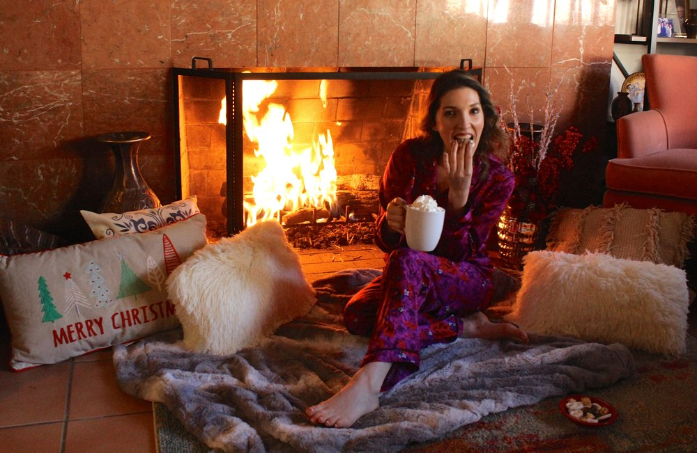 I have practically been living in front of my fireplace this past month and will probably continue for the next month. As you can see above I have practically built a little home for me to hibernate in during these cold nights. I have also been living in these super soft silky pajamas that I got from Target! I love their bright floral design ( of course!), but better than that, they are so warm and soft. I have never owned a pair of silk pis but now that I do, I feel so fancy, and recommend that every lady get herself a pair! So if anyone needs me, I'll be here for the next month, keeping warm, eating sweets, and loving every minute of it!  Stay warm and thanks for stopping by!  PJs:  Target   xx Nicole