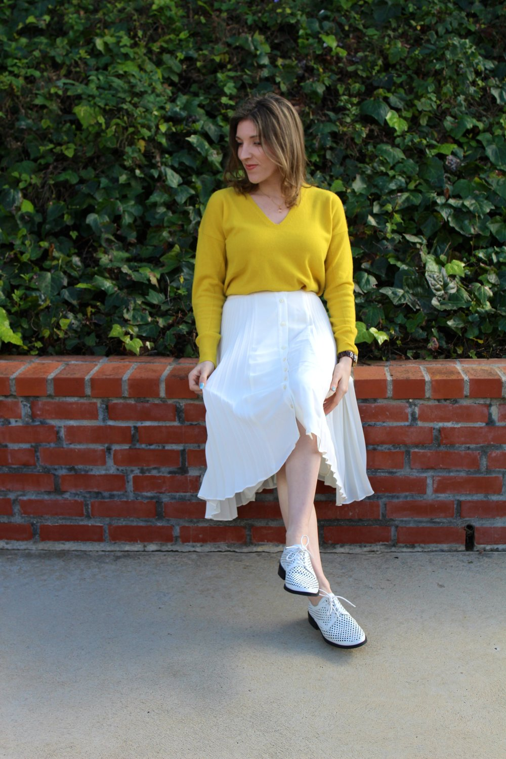 Top: Banana Republic,  similar here  // Skirt: Banana Republic,  similar here  // Shoes: Forever 21,  similar here     It sure has been raining a lot here in Los Angeles! As much as I love the rain and as much as we do need it, I am looking forward to my bright and sunny spring weather. This past week we had a clear somewhat warmish day, so of course I took full advantage. And although the weather didn't really permit for me to wear this, I had to anyways. I am craving spring and sunshine.     How fun is this bright yellow cashmere sweater?! It is so soft and I am in love with the color. Such a pop of fun! And who doesn't like to don a soft cashmere sweater? I have been living in them all winter long! I have worn this beautiful white midi skirt in a previous post, but by pairing it with a tucked in sweater, it changes the look all together! I love having pieces in my closet that are interchangeable and with one tweak can be totally transformed! I threw in a fun white oxford shoe to tie the whole look together and scream SPRING! I love this white and yellow color combo for spring as well! Hopefully the rain will bring a beautiful spring full of beautiful flowers and brightness! Looking forward to my new spring wardrobe as well! Stay tuned for new posts!    As always, thanks for stopping by! Have a great Wednesday friends!  ~ Nicole