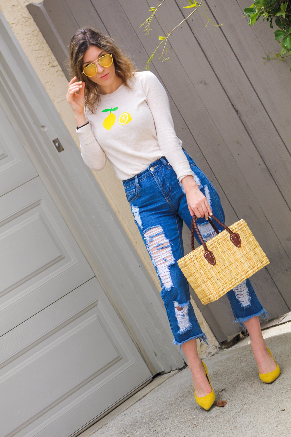TOP : J.Crew,   similar here   //  JEANS:  F21   //  HEELS : BR,   similar here   //  BAG : Global Goods Partners,   similar here   //  SUNNIES :   F21         Yellow is a color that has become extremely popular this past year. I say it's the color of 2017! Because of its vibrancy, I find myself gravitating to more and more yellow pieces. Retailers are slowly producing more and more items in different shades of yellow so there is no shortage when looking for a great yellow piece to integrate into your wardrobe. These heels, sunnies, and lemon on my sweater add just the right pops of color to this look. The color is not overpowering, so you can wear all this yellow in one look! I have recently bought a lot of yellow pieces and can't wait to share them with you guys in upcoming summer posts!         The lemon print is another trend that is perfect for the summer. This sweater is so darling and just screams summer to me! I love that this sweater comes in a lightweight wool so it is still cool enough to wear in the warm summer months. Next up I'll be pairing it with a pair of denim roll up shorts and trainers for a day of running errands, but it would be a perfect beach sweater to wear over a bathing suit as well. There are so many great lemon print items on the market right now. I am obsessing over    this dress    ,  this skirt , and  this bathing suit !         I am getting too thrilled for summer! All I need is for the June gloom to go away and the warm temps to rise! Beach... Here I come!        I hope you all have the best day!!!       xoxo   ~ Nicole