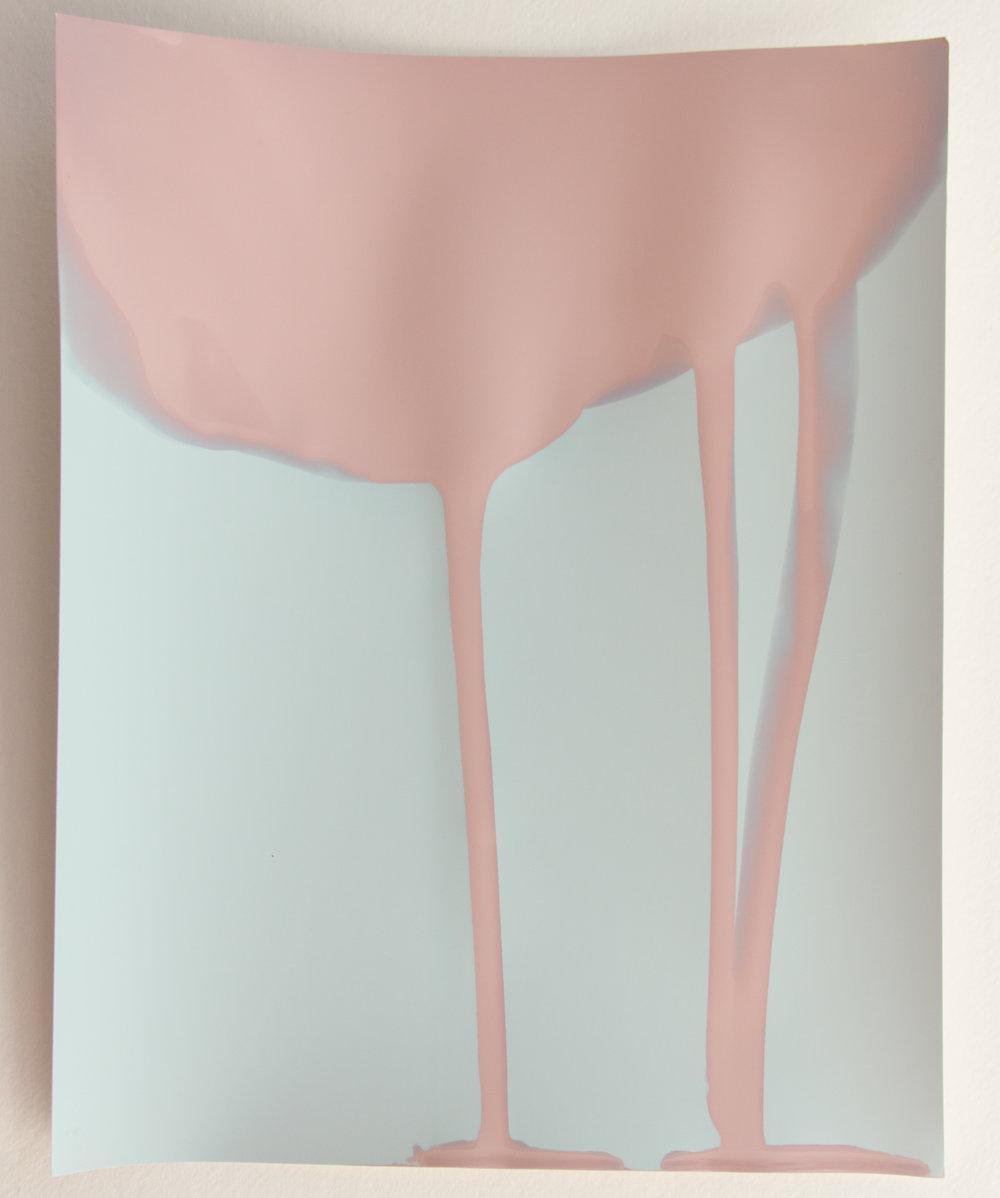 An unfixed silver gelatin print in development.