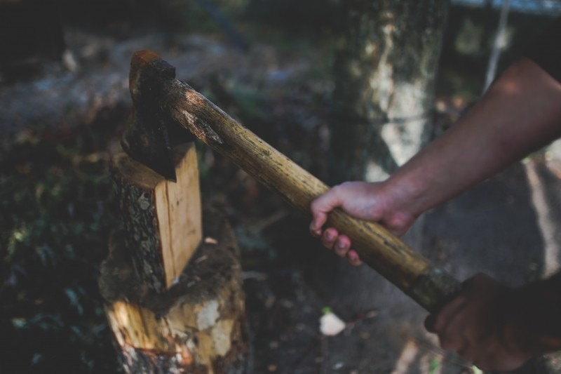 man-hold-old-vintage-worn-axe-wood.jpg