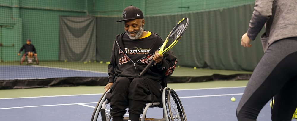 A man plays wheelchair tennis.