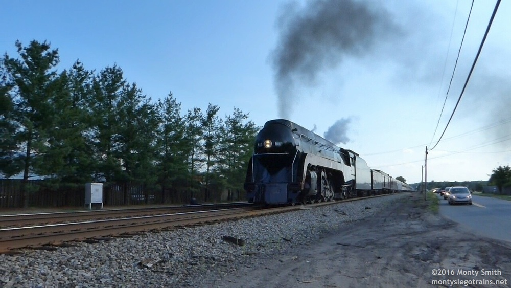 NS 957 Northbound at Bealeton, VA. Note line of railfans pacing the train at right.