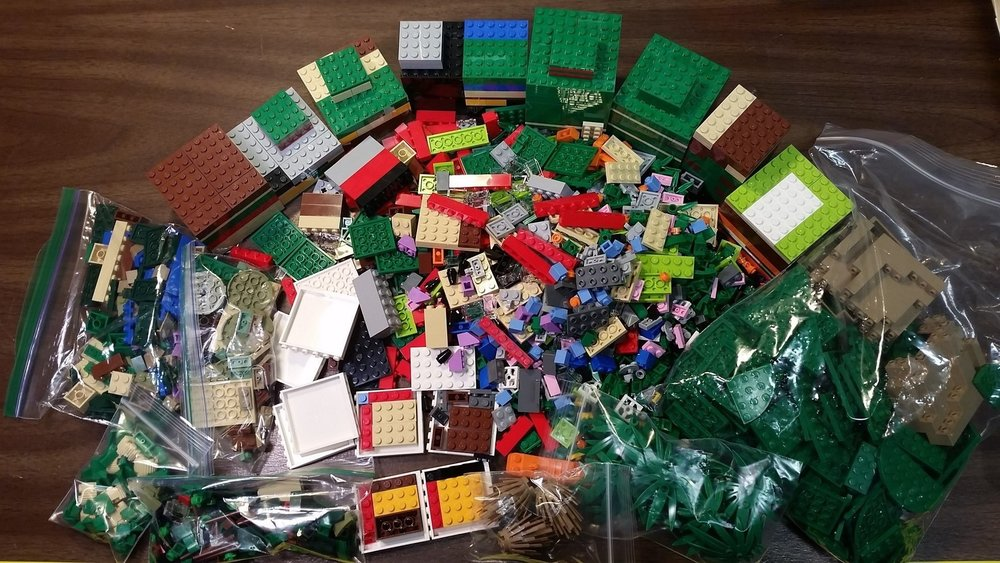 My haul from my first PAB wall visit in May. Across the top you can see the towers I built inside the cups. Look to the bottom, and you'll see I managed to fit some bricks by building the 6x6x1 wall sections into boxes. It's not much, but it's 25 more studs of brick than I would have had otherwise! The plastic bags are from two Bricklink orders that arrived on the same day.